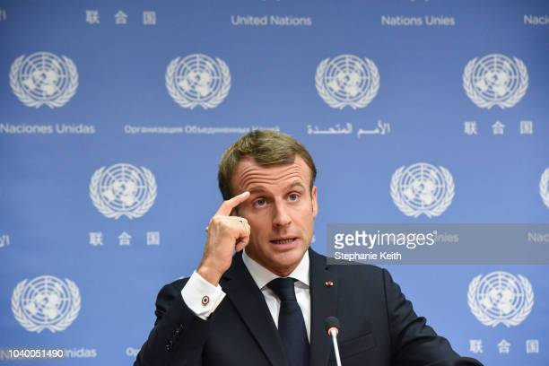 French President Emmanuel Macron leaves after holding a press briefing during the United Nations General Assembly on September 25 2018 in New York...