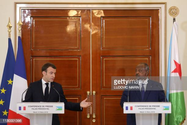French president Emmanuel Macron holds a press conference with Djibouti president Ismael Omar Guelleh at the presidential palace in Djibouti on March...