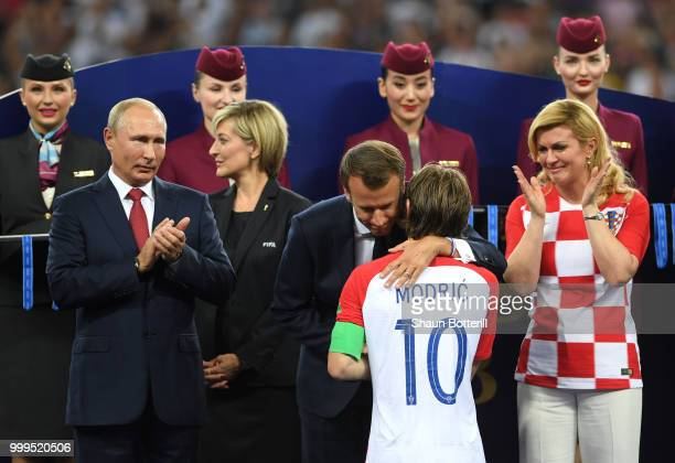French President Emmanuel Macron hugs Luka Modric of Croatia as President of Russia Vladimir Putin and President of Croatia Kolinda Grabar Kitarovic...