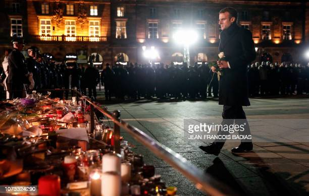 French President Emmanuel Macron is about to lay a white rose at a monument near the Christmas market in Strasbourg eastern France used as a...