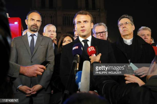 French President Emmanuel Macron is accompanied by Mayor of Paris Anne Hidalgo French Prime Minister Edouard Philippe French Culture Minister Franck...
