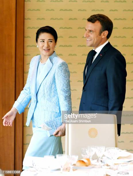 French President Emmanuel Macron is escorted by Empress Masako prior to the luncheon at the Imperial Palace ahead of the G20 summit on June 27, 2019...