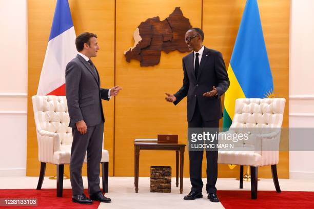 French President Emmanuel Macron is greeted by Rwandan President Paul Kagame at the Presidential Palace prior to a bilateral meeting in Kigali on May...