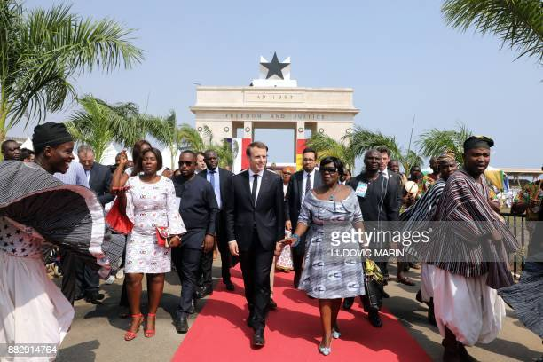 French President Emmanuel Macron is greeted by traditional dancers as he takes part in a welcoming ceremony at the Independence square upon his...