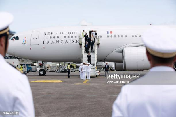 French President Emmanuel Macron is greeted upon arrival as he disembarks from the French presidential aircraft at the start of his visit at the...