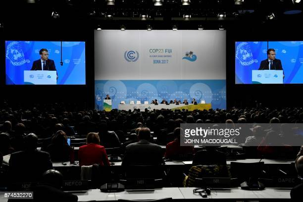 French President Emmanuel Macron is seen on giant screens as he speaks during the UN conference on climate change on November 15 2017 in Bonn western...