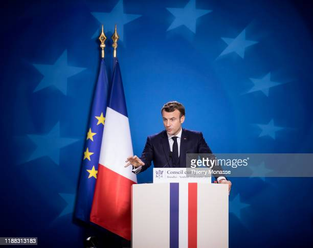 French President Emmanuel Macron is talking to media at the end of a two-day summit of European Union leaders on December 13, 2019 in Brussels,...