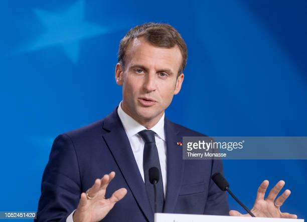 French President Emmanuel Macron is talking to media at the end of an EU chief of state summit in the Europa the EU Council headquarter on October 18...
