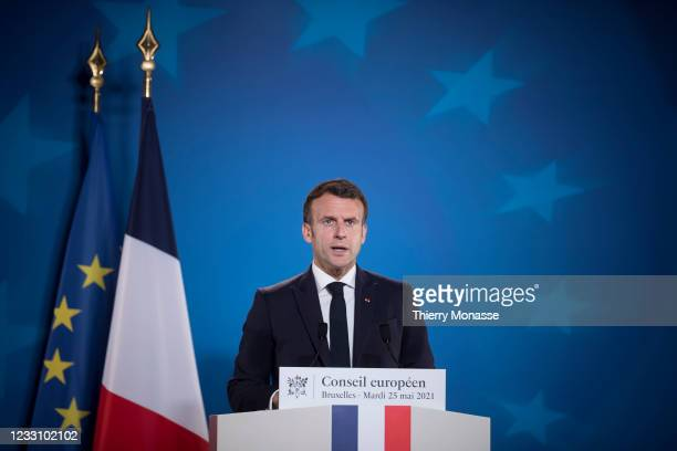 French President Emmanuel Macron is talking to media at the end of an extraordinary EU Summit on May 25, 2021 in Brussels, Belgium. European Union...