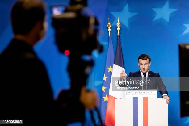 French President Emmanuel Macron is talking to media at the end of the second day of an EU Summit in the Europa, the European Union Council...