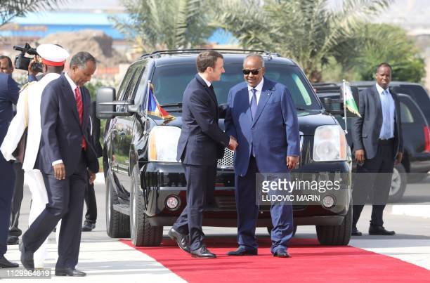French president Emmanuel Macron is welcomed by Djibouti president Ismail Omar Guelleh during the official military welcome ceremony at the...