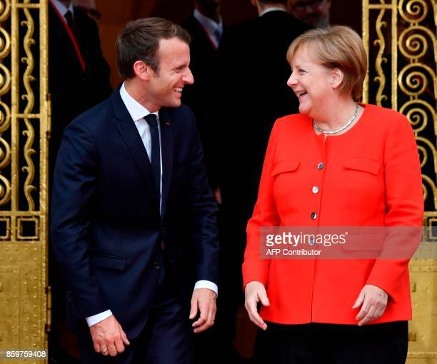 French President Emmanuel Macron is welcomed by German Chancellor Angela Merkel for bilateral talks before opening the Frankfurt Book Fair on October...