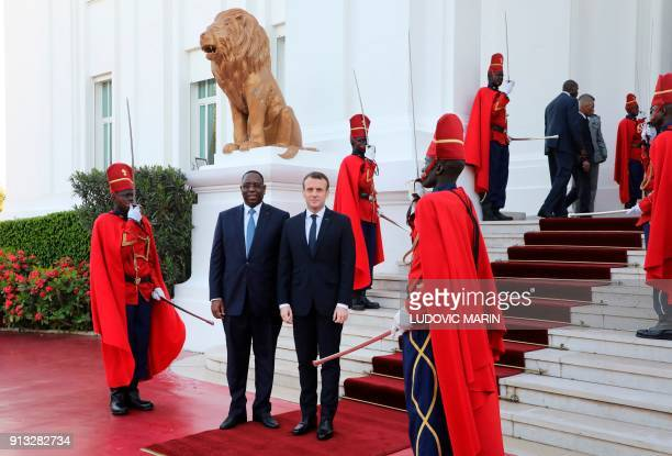 French President Emmanuel Macron is welcomed by Senegalese President Macky Sall at the presidential palace in Dakar on February 2 2018 PHOTO /...