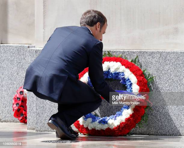 French president Emmanuel Macron lays a wreath at the foot of the statue of Queen Elizabeth, The Queen Mother during a ceremony to commemorate the...