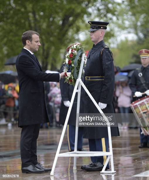 French President Emmanuel Macron lays a wreath at the Tomb of the Unknown Soldier on April 24, 2018 at Arlington National Cemetery in Arlington,...