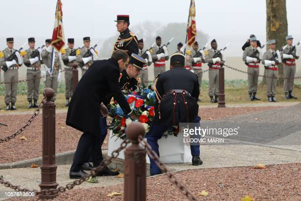 French President Emmanuel Macron lays a wreath during a ceremony in tribute to the French soldiers killed in August 1914 during border battles at the...