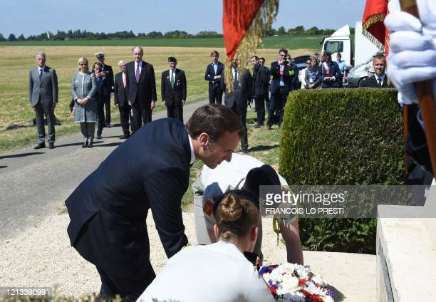 French President Emmanuel Macron lays a wreath during a ceremony in La-Ville-aux-Bois-les-Dizy, northern France on May 17 for the 80th anniversary of...