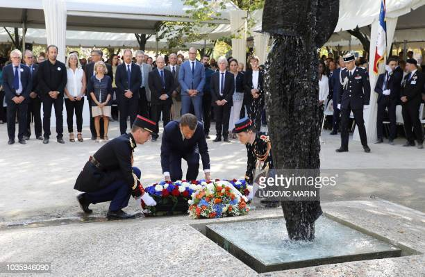 French President Emmanuel Macron lays a wreath of flowres in front of a memorial fountain during a national ceremony to pay tribute to the victims of...