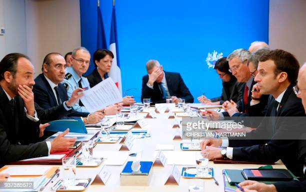 French President Emmanuel Macron leads a Defense and Security Council meeting attended by officials and ministers including Prime Minister Edouard...