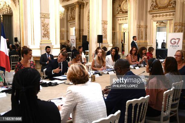 French President Emmanuel Macron leads a meeting of the G7 Advisory Council for Equality between Women and Men as part of the 'Day of Dialogue' with...