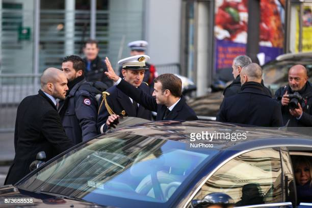 French President Emmanuel Macron leaves after a ceremony at Paris 11th district town hall on November 13 during ceremonies held for the victims of...