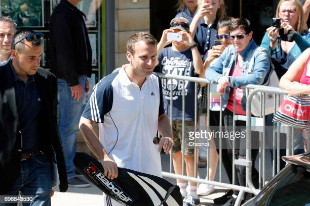 French President Emmanuel Macron leaves his house dressed for tennis on the eve of the second round of the French parliamentary elections on June 17...