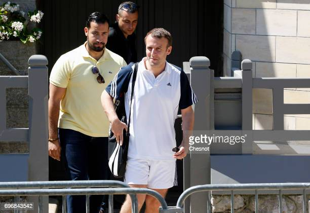 French President Emmanuel Macron leaves his house dressed for tennis with his deputy chief of staff Alexandre Benalla on the eve of the second round...