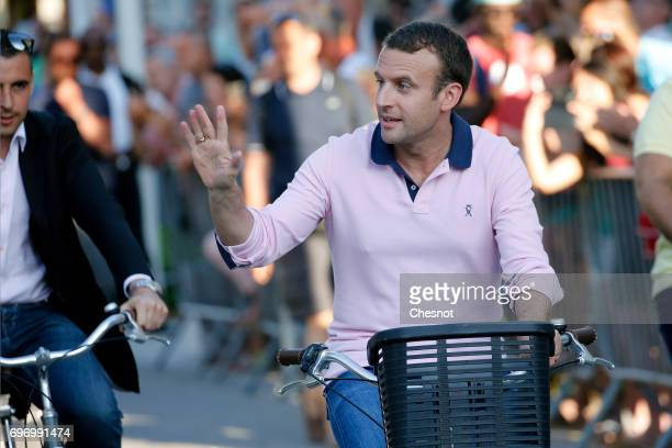 French President Emmanuel Macron leaves his house on a bicycle on the eve of the second round of the French parliamentary elections on June 17 2017...
