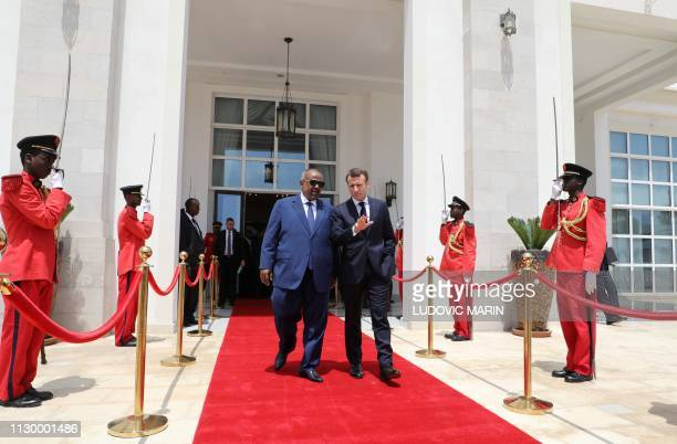French president Emmanuel Macron leaves with Djibouti president Ismail Omar Guelleh at the presidential palace in Djibouti on March 12 2019 French...