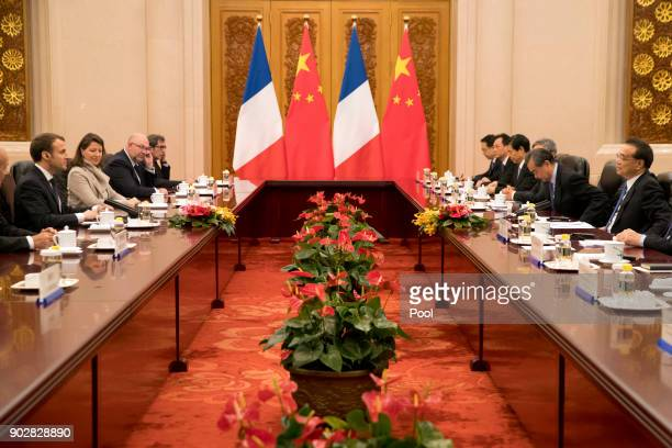 French President Emmanuel Macron left and Chinese Premier Li Keqiang right attend a meeting at the Great Hall of the People on January 9 2018 in...