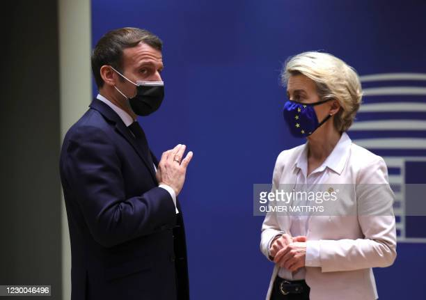 French President Emmanuel Macron, left, speaks with European Commission President Ursula von der Leyen during a round table meeting during an EU...