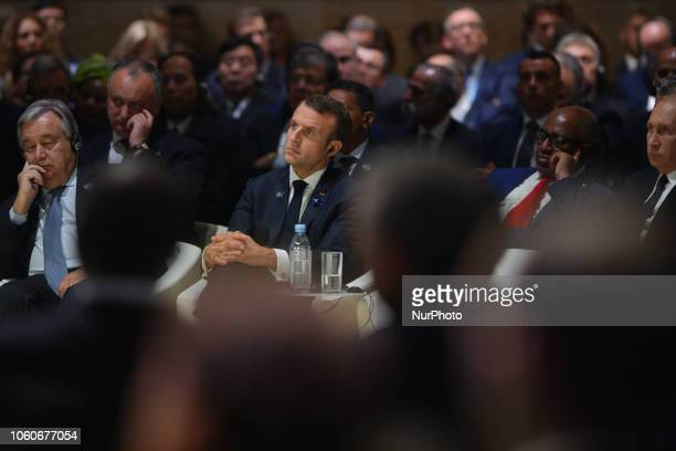 French President Emmanuel Macron listen Angela Merkel's speech at the opening session of the Paris Peace Forum an event that is a part of the...