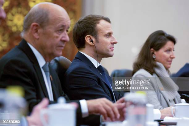 French President Emmanuel Macron listens during a meeting with Chinese Premier Li Keqiang at the Great Hall of the People in Beijing on January 9...