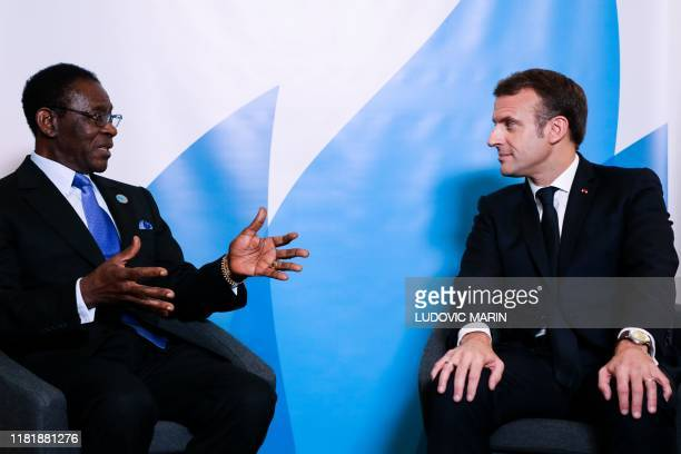 French President Emmanuel Macron listens to Equatorial Guinea's President Teodoro Obiang Nguema Mbasogo during a bilateral meeting as part of the...
