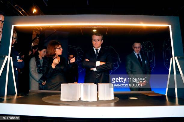 French President Emmanuel Macron listens to exhibition curator Astrid Aron as he visits the exhibition 'Pasteur the Experimenter' at the Palais de la...