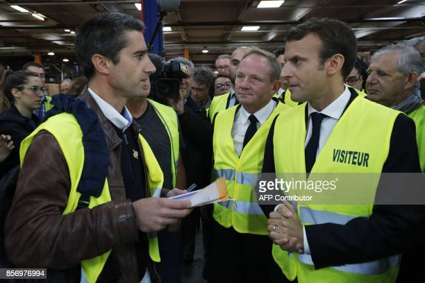 French President Emmanuel Macron listens to La France Insoumise leftist party's MP Francois Ruffin during a visit to the Whirlpool factory in Amiens...