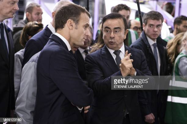 French President Emmanuel Macron listens to Renault CEO Carlos Ghosn during a visit of the Renault factory in Maubeuge northeastern France on...