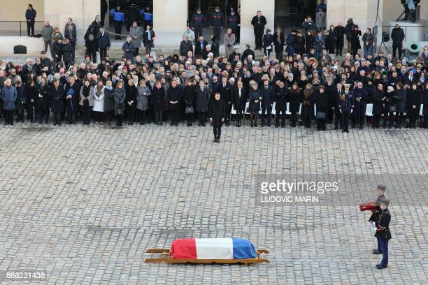 TOPSHOT French President Emmanuel Macron looks at the coffin of late member of the Academie Francaise Jean d'Ormesson during his National Tribute...
