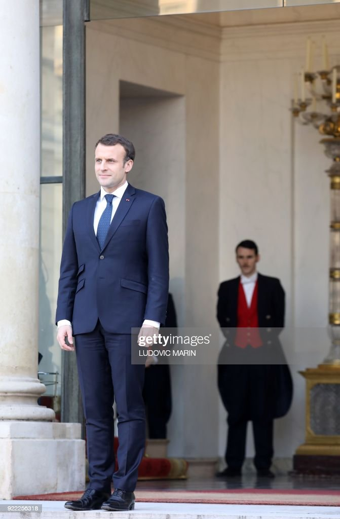 French President Emmanuel Macron looks on after a meeting with the Liberian President at the Elysee presidential palace on February 21, 2018 in Paris. /