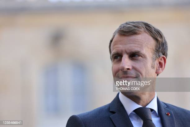 French President Emmanuel Macron looks on after a working lunch with Lebanese Prime Minister at the Elysee Palace, in Paris, on September 24, 2021.