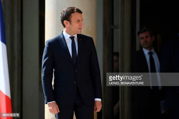 French President Emmanuel Macron looks on after escoring his Senegalese counterpart following their meeting at the Elysee palace on June 12, 2017 in...