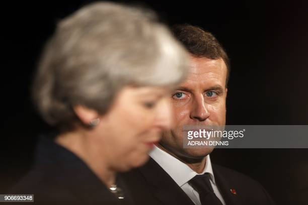 TOPSHOT French President Emmanuel Macron looks on as Britain's Prime Minister Theresa May speaks at an event at the Victoria and Albert museum in...