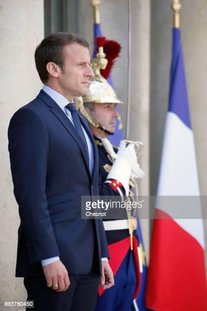 French President Emmanuel Macron looks on as he waits for Peruvian President Pedro Pablo Kuczynski prior to their meeting at the Elysee Presidential...