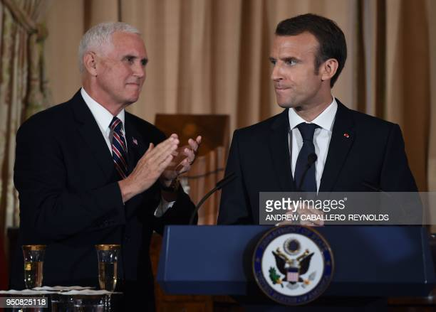 French President Emmanuel Macron looks on as US Vice President Mike Pence gestures during a luncheon at the US State Department in Washington DC on...