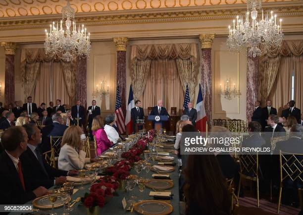 French President Emmanuel Macron looks on as US Vice President Mike Pence speaks during a luncheon at the US State Department in Washington DC on...