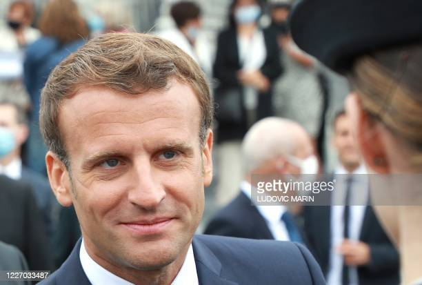 French President Emmanuel Macron looks on at the end of the annual Bastille Day military ceremony on the Place de la Concorde in Paris on July 14...