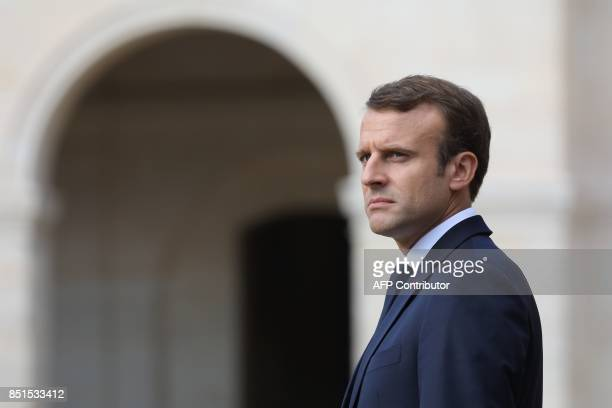 French President Emmanuel Macron looks on during a ceremony in tribute to late French WWII colonel Fred Moore at the Hotel des Invalides in Paris on...