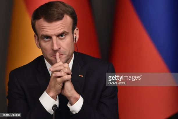 French President Emmanuel Macron looks on during a conference in a summit called to attempt to find a lasting political solution to the civil war in...