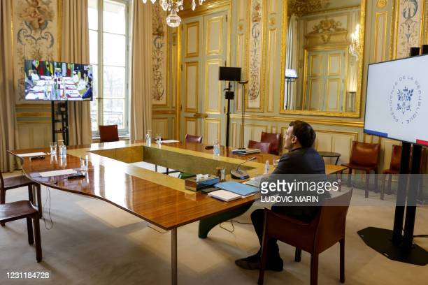French President Emmanuel Macron looks on during a meeting via video-conference with leaders of the G5 Sahel as they attend a two-day summit in...