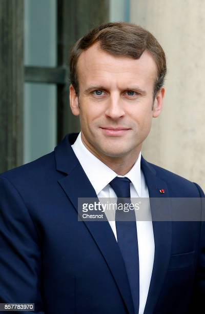 French President Emmanuel Macron looks on prior to his meeting with Iraq's Prime Minister Haidar AlAbadi at the Elysee Presidential Palace on October...